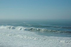 Pacific Ocean waves crash in like a giant clock, blue forever, San Gregorio State Beach, California, USA