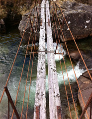 On the Bridge (3474) (oobrien) Tags: bridge water danger fence wooden missing rust iron rusty plank rushing rickety