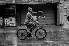 Rain won't stop me.... (Ajwad Mohimin) Tags: bnw black white bangladesh canon canon60d candid cycle motion rain rainyday blackandwhite bw bangladeshi ngc