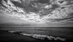 Sun starting to set (mswan777) Tags: beach monochrome black white ansel bw sunset sky clouds water waves sand lake michigan great lakes nikon d5100 sigma 1020mm seascape shore evening summer
