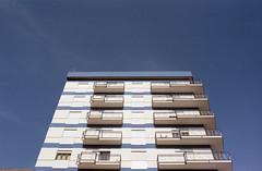 BLEUx (zebilibouba) Tags: pentax me fujifilm superia 200 sicile sicily sicilia mazara del vallo blue white building flat sun italy abstract pentaxmefujifilmsuperia200