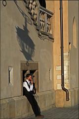 """Break time"" - Krakow, Poland (TravelsWithDan) Tags: waiter breaktime smoking sunsetlight townsquare oldtown krakow poland candid canong16"