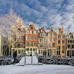 Softly silent snow settles in the heart of Amsterdam (Bn) Tags: world street trees windows winter sunset people sun seagulls house snow cold holland heritage church water netherlands dutch amsterdam weather bike corner walking frank polaroid anne boat canal cozy cool topf50 colorful day shadows jan snowy walk seagull sneeuw bikes atmosphere scooter file canals unesco brug snowfall sled topf100 mokum rembrandt meeuw meeuwen gezellig cafs jordaan herengracht sleding bycicle westertoren brouwersgracht nowandthen pakhuis lange noordermarkt westerkerk wester celcius annefrankhuis grachtengordel rondvaartboot 1000km 100faves 50faves 1c