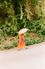 (Carolinewtucker) Tags: travel portrait orange umbrella religious photography monk laos robes parasole