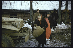 American GIs help fleeing local residents to load themselves and their belongings onto a truck during a lull in the fighting during the last days of the Battle of the Bulge. ca. Dec. 1944 - Jan. 1945. (f//stop) Tags: last truck during major us belgium action refugees country wwii ardennes battle days help german american local wars foreign load offensive gi forces belongings fleeing lull bulge armed residents onto timeincown 5926083