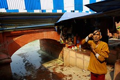 to the sun   Kolkata (arnabchat) Tags: winter india man canon river asia prayer religion offering hindu kolkata bengal puja calcutta incense bharat westbengal hooghly 1740f4l ghaat 2013 arnabchat babughaat