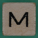 Spill and Spell Dice Letter M