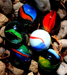 Colour in the stones (Julie RY) Tags: sunlight colour macro glass fun toys backyard stones marbles childhoodtoys backyardcaptures macrofilter|