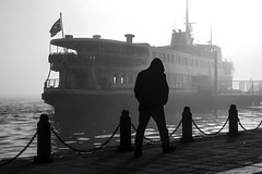 vapur (Berkan Byktmbk) Tags: street streetphotography streetphoto streetphotobw fujifilm xt1 bw blackandwhite monochrome man walking dark human people outdoor sea ship flag