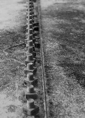 Bolts (The Moon & Back) Tags: rust bolts industrial bw black white old structure minimal simple tools rivet light dark shadow linear