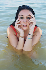 - (Giorgi Roberta) Tags: sea mare summer end girl portrait water reflection brown brownhead hands orange allaperto italy outside wet hair curly intense eyes
