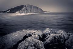 West Bay, Bridport (Explored) (pollylew) Tags: sea summer blackandwhite landscape rocks cliffs 2009 bridport westbeach