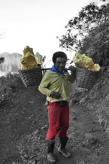 Miner at Ijen - colour adjusted (nic0704) Tags: lake toxic yellow danger work indonesia dead volcano java asia mine south mining east crater sulphur volcanic miner deposits ijen
