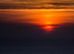 Blood Red (intrazome) Tags: ocean sunset red sea orange cloud sun color colour nature beautiful weather night clouds landscape evening coast nikon cloudy d5100