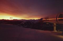 (xbacksteinx) Tags: morning winter sky sun snow clouds analog sunrise 35mm snowboarding switzerland early mood moody laax expiredfilm pointnshoot olympusmjuii lomocolornegative100