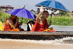 Monks speeding by on Inle Lake, Myanmar (chrisjohnbeckett) Tags: blue orange umbrella boat burma wave monk parasol myanmar inlelake waving canonef24105mmf4lisusm chrisbeckett