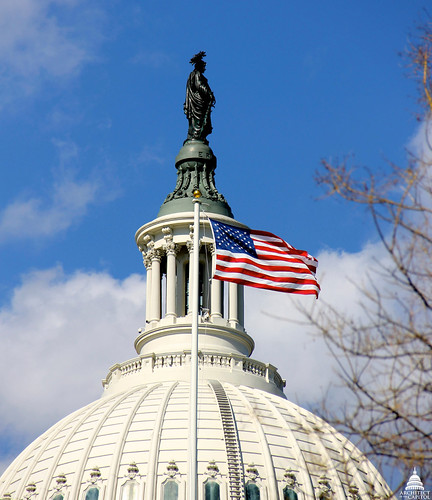 Statue of Freedom with flag flying over US House of Representatives
