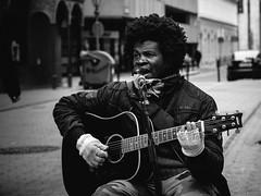 Purple haze (Dvid Papp) Tags: portrait contrast downtown glow guitar budapest panasonic hidden talent tele utca g3 zuiko guitarist 45mm ferenc tr dek vci