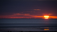 Harvesting the wind (ullage22) Tags: sunset sea sun water weather clouds twilight sand waves wind shoreline lancashire windfarm