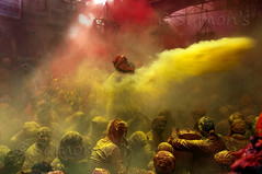 Throw l Holi, Mathura (mann_D5000) Tags: light red people orange india mist holiday festival rural evening village play delhi enjoy getty tamron holi dense mathura holifestival sumon d5000 holiindia radharanitemple d5000tamron1750