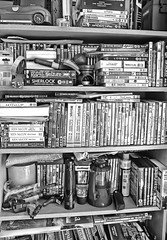 Bookcase chaos (*Melody*) Tags: bw lamp car lights candle books torch collections bookcase dvds