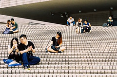 Couples (DanLeeGreen) Tags: china hk hong kong street canon 50mm prime 35mm kodak ultramax candid colour film chinese couples symmetry lines line