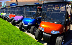 Rush Hour in Sun City West, AZ (oybay) Tags: suncitywest arizona color colors golfcarts golf carts rushhour enmasse earlybirdspecial grass green brown blue purple red yellow