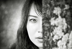 Hidden Vision (Ben Heine) Tags: wood portrait blackandwhite woman blur tree cute nature girl beauty face look closeup composition mouth garden hair asian nose photography intense model eyes focus belgium emotion femme details yeux sparkle beaut canon5d feeling pure visage regard asiatique zhuzhu benheine hiddenvision