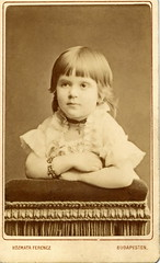 1879. Little girl with bracelet (elinor04) Tags: portrait girl fashion vintage studio photo kid chair hungary photographer child cross budapest style velvet bracelet cdv ribbon collar jewels lacy pendant 1879 1870s sidechair ferenc voyeuse kozmata kzmata kozmataferenc kzmataferenc