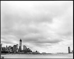 Skyline (Ryan M Long Photography) Tags: world new york nyc white ny black classic film statue liberty photography center 150 400 fujifilm hp5 medium format wtc 6x7 rodinal trade ilford fujinon 67 ebc 80mm f35 gf670
