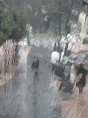 The rain in Spain (Claire Wroe) Tags: road street city people brown tree green wet water glass car rain weather umbrella grey spain pavement gray asturias inside van oviedo minibus