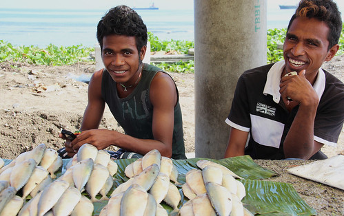 Two men sell fish at a roadside stall in Dili, Timor-Leste. Photo by Holly Holmes, 2013