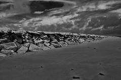 Drake's Island (Bud in Wells, Maine) Tags: bw beach monochrome clouds rocks maine wells coastal breakwater drakesisland