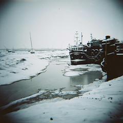 Indianna, Leigh-on-Sea (nick richards art) Tags: winter sea england snow colour 120 beach water thames boats coast seaside lomo lomography ship 120film diana coastal analogue dianaf essex southend analoguephotography