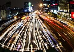 Twilight Traffic in Taipei, Taiwan (Greg - AdventuresofaGoodMan.com) Tags: road street city longexposure nightphotography urban night taiwan headlights taipei lighttrails carlights stoppedtraffic qsquaremall