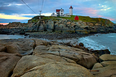 Across to the Island - in explore (SunnyDazzled) Tags: ocean york longexposure light sunset sea coastguard lighthouse seascape history beach nature station landscape island coast harbor scenery colorful skies stones maine cliffs story rosy boyinthebucket redoilhouse