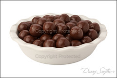 Chocolate Malt Balls (Danny Smythe) Tags: stilllife food brown macro reflection closeup cutout ceramic dessert shiny pieces candy sweet chocolate object nobody bowl sugar gourmet whitebackground pile snack round produce studioshot treat isolated confectionery confection ingredient malt fattening clippingpath singleobject chocolatemaltballs isolatedonwhite