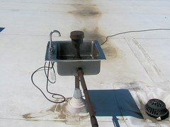 Rooftop Sink (Eyellgeteven) Tags: roof white building rooftop water strange weird wire rust stainlesssteel sink recycled steel pipes pipe rusty steam drain odd wires rusted faucet wtf oxidised eyellgeteven