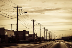 Quiet Saturday Morning (devel_) Tags: street light canada calgary sepia buildings industrial quiet power post empty ab line pole alberta 2013 110365