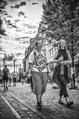 At least She's happy about it (tootdood) Tags: canon70d blackandwhite streetcandid candid fromthehip trees leaves cobbles couple ihateeveryone atleastsheshappyabooutit laughing happy