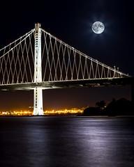 Moonrise over Bay-Bridge (BiGYaN, ) Tags: us 2016 treasureisland baybridge moon moonrise water smoothwater bridge architecture night nightphotography nightscape sanfrancisco sfo light fullmoon
