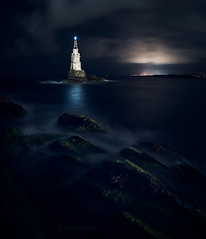 The mystery of night (emil.rashkovski) Tags: night lighthouse sea ocean sky clouds rocks light mystery nature outdoor seagrass