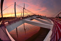 Bridge at Kaomei Wetland  (Vincent_Ting) Tags:      sunset  clouds wetland windmill  windturbine  silhouette    taiwan formosa sky water  reflection   seaside sea beach colorfulbeach     jetty crepuscularrays vincentting