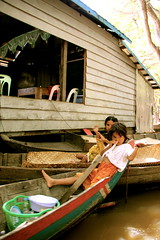 Just hanging out (janoski006) Tags: boy woman lake water girl forest river children boat women asia cambodia tour village child ride south paddle floating row east siem reap guide float sap kompong tonle pluk