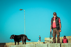 A Man with his Best Friend (Mindful Youth) Tags: countydublin dog dublin figure howth howthhead howthpier interface ireland irishsea nikond90 peninsula student sun bestfriend bluesky calm clear cloudless coast human man mansbestfriend people person pet pier sea sunny