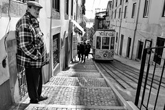 Wait (Fernando_PC) Tags: street men portugal stairs standing blackwhite eyecontact flickr downtown close pov lisbon candid low streetphotography tram sidewalk baixa busstation bica x10 streetphotographer lowpov 500px juststreet fujifilmx10 fernandopc