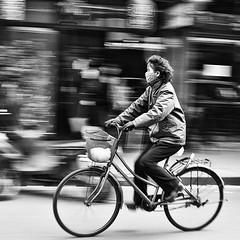the masks we wear (~mimo~) Tags: china street blackandwhite woman blur bike bicycle square photography asia shanghai mask pollution honesty panning globalwarming odc themaskswewear mimokhair atmyfavoritecoffeeshop wherelifemovesinslowmotion