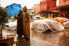 Laughing in the rain (antonioVi (Antonio Vidigal)) Tags: rain laughing gimp morroco marrakech marrakesh raining antoniovidigal antoniovi