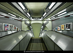 Heading Downward Tube (Edwinjones) Tags: pictures city uk england urban color colour building london art texture lines architecture modern stairs train underground subway photography grey lights design hall photo shiny colours metro photos metallic sony escalator tube perspective picture sigma piccadilly wideangle pic science tubestation artdeco londonunderground sciencefiction dslr futuristic topaz boundsgreen undergroundstation photomatix tonemapped dslra700