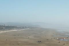 Ocean Beach; Big Sky; Ready for wind (Biking Nikon SFO) Tags: sanfrancisco goldengatepark beach windmill haze pacific sunny seawall bikeride sunbathers nikond200 50mmf14nikkor